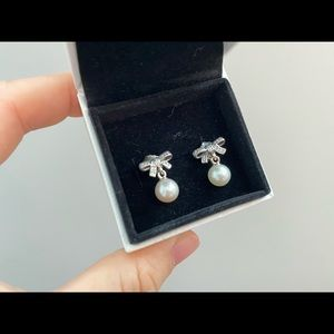 Brand new Pandora bow tie pearl earrings